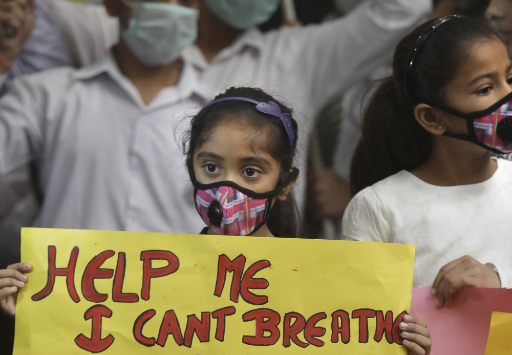 An Indian girl holds a banner during a protest in New Delhi on Sunday.