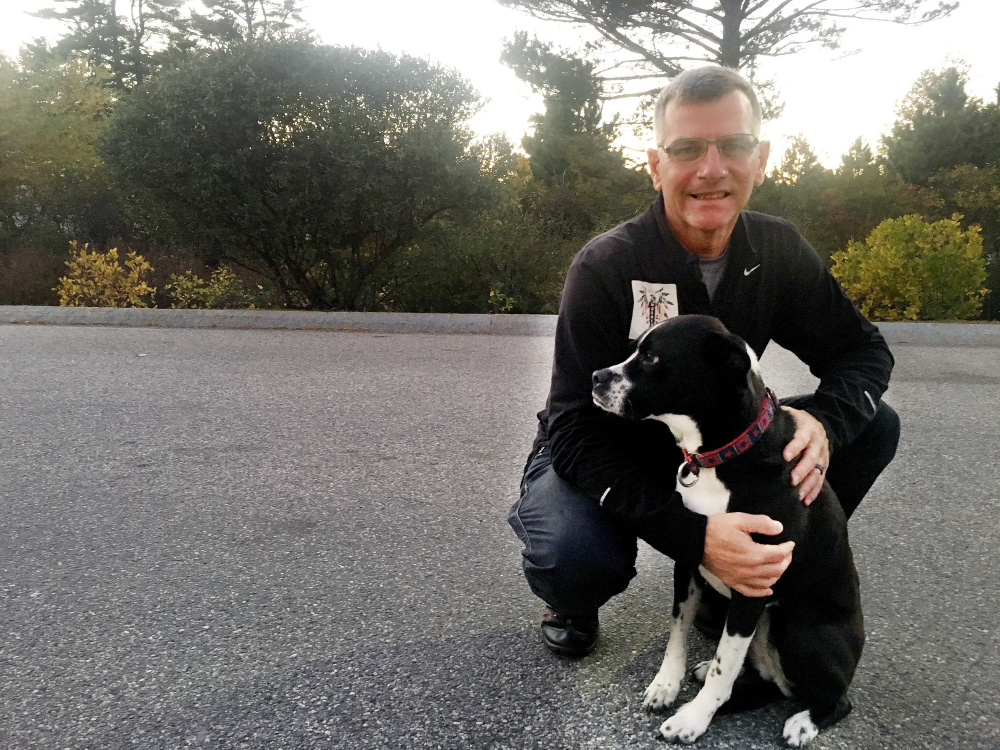 Richard Brewer of Falmouth earned a Purple Heart among many other medals. He founded the nonprofit One Warrior Won. He's with his service dog Anka. (Photo by Heather Steeves)