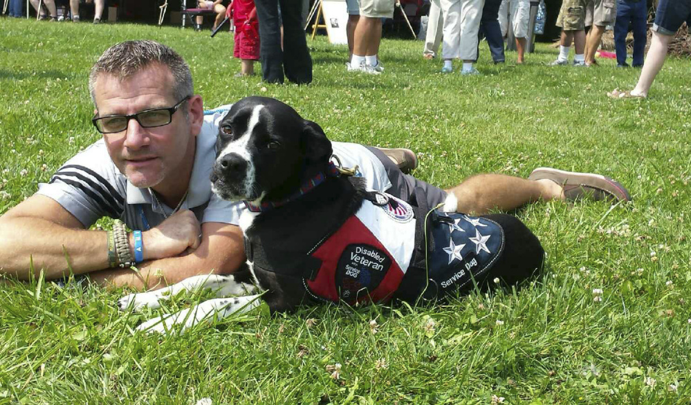 Richard Brewer in 2015 with his service dog, Anka.