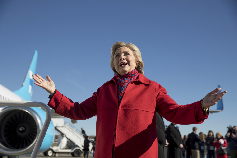 Democratic presidential candidate Hillary Clinton speaks to members of the media before boarding her campaign plane at Westchester County Airport in White Plains, N.Y., Monday to travel to Pittsburgh.