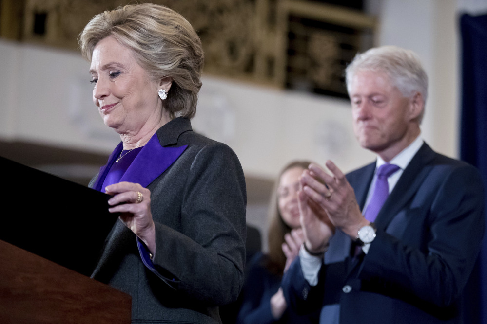 Democratic presidential candidate Hillary Clinton, left, accompanied by her husband former President Bill Clinton, finishes speaking at the New Yorker Hotel in New York on Wednesday, when she conceded her defeat to Republican Donald Trump after the hard-fought presidential election.