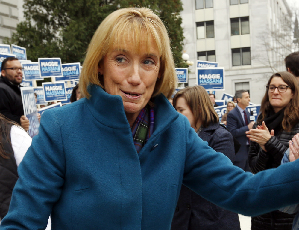 New Hampshire's newly elected Democratic senator, Gov. Maggie Hassan, left, speaks with supporters at the Statehouse in Concord on Wednesday. Her race with incumbent Republican Sen. Kelly Ayotte, right, was one of the nation's most closely watched.