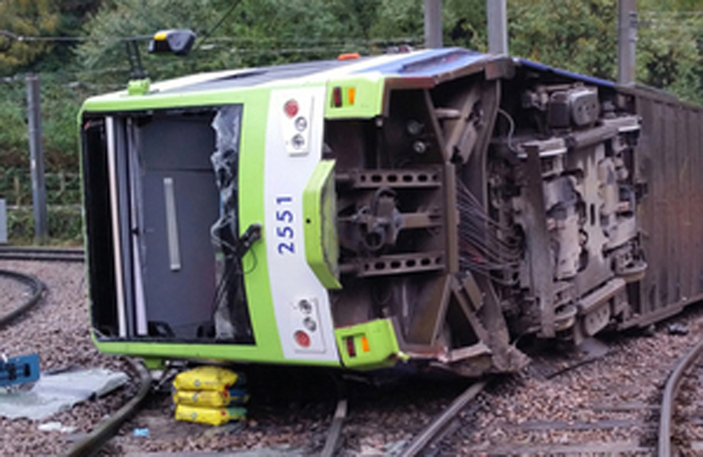 A photo issued by the Rail Accident Investigation Branch of the tram which derailed near the Sandilands stop in Croydon, London, Wednesday, Nov. 9, 2016. Several people were killed and more than 50 injured when a tram derailed in south London during a heavy rainstorm before dawn Wednesday, police said.