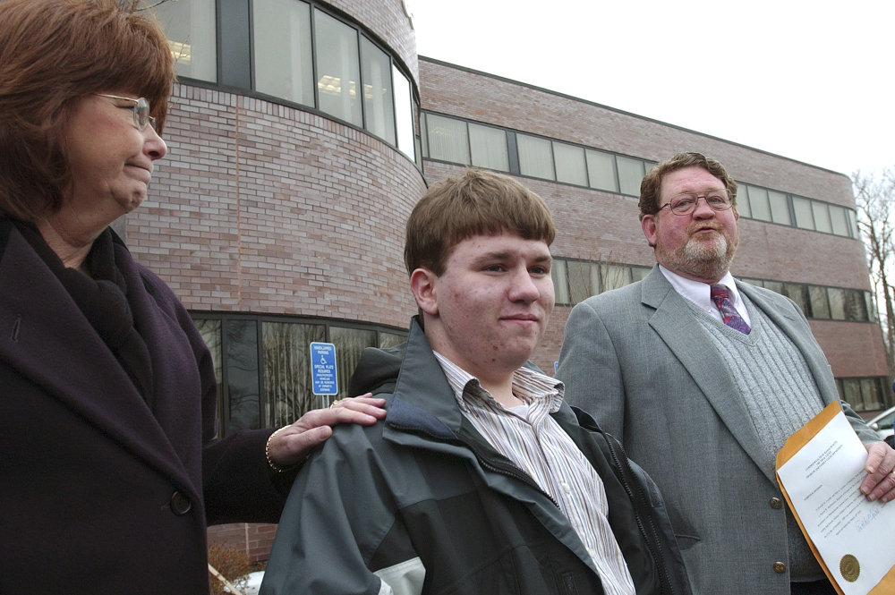 Patrick Holland stands with his adoptive parents, Rita and Ron Lazisky, after his adoption was finalized at the Norfolk County Probate Court in Canton, Mass., in 2005. Holland was granted a ground-breaking