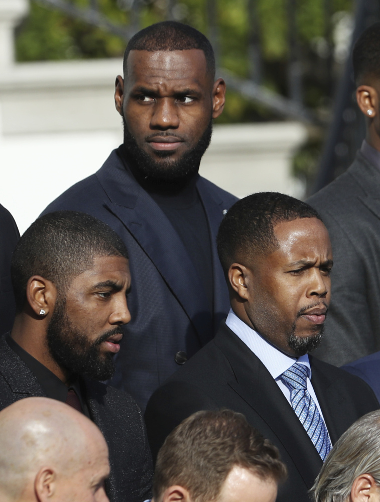 LeBron James, back, and fellow Cleveland Cavaliers are honored in Washington.