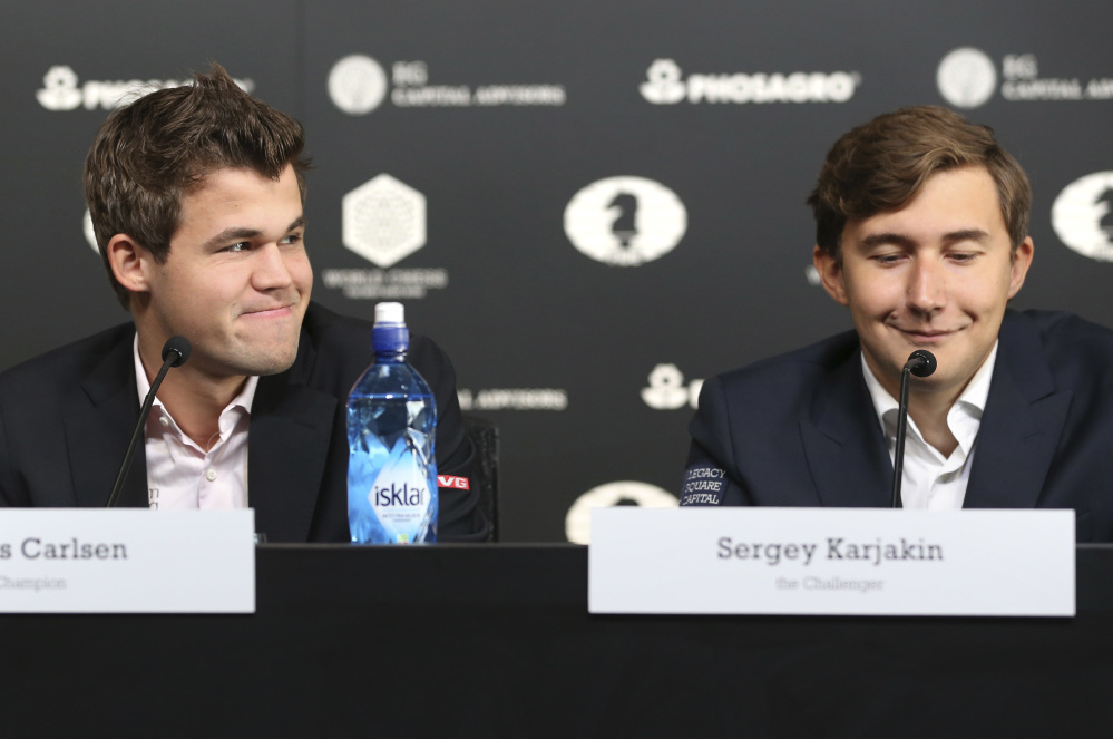 Magnus Carlsen of Norway, left, will defend his title against challenger Sergey Karjakin of Russia when the two face off Thursday in the World Chess Championship in New York.