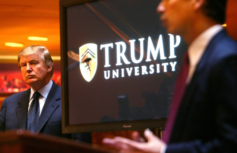 Donald Trump is introduced in May 2005 as the establishment of Trump University is announced in New York. Trump faces two class-action fraud suits from Trump University students.