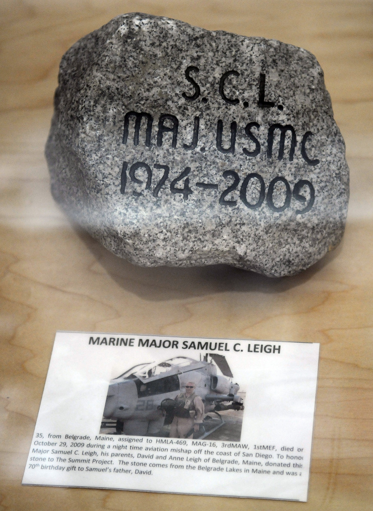 A stone in memory of Marine Corps Maj. Samuel Leigh stands on display Thursday at the Togus VA as part of the Summit Project. Stones picked by relatives of several veterans who have died since Sept. 11, 2001, are on display in the lobby of the hospital. A Belgrade resident, Leigh was a 13-year veteran of the Marine Corps who served two tours of duty in Iraq before dying in an aerial accident on Oct. 29, 2009.