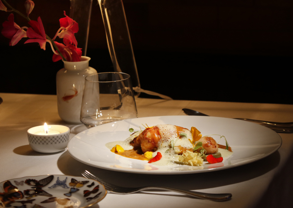 Penang poached lobster tail at Tempo Dulu. Gregory Rec/Staff Photographer