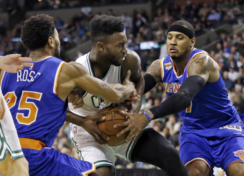 New York's Derrick Rose, 25, and Carmelo Anthony try to tie up the ball controlled by Boston's Jaylen Brown in the first quarter Friday night in Boston.