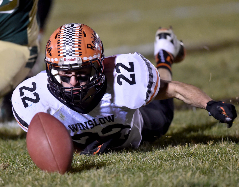 Winslow's Nate St. Amand tries to recover a fumble during the Class C North championship game Friday night against Mt. Desert Island. Top-seeded MDI won the regional title with a 12-7 victory over the two-time defending state champions.