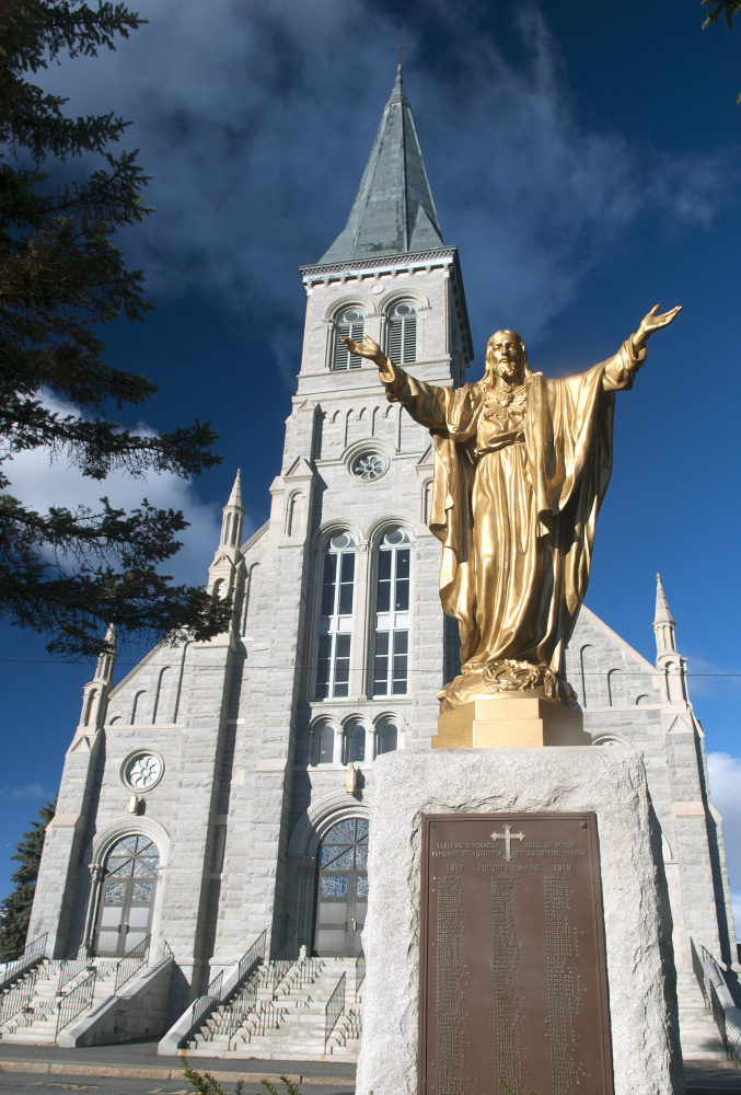 St. Augustine Church in Augusta is celebrating the centennial of the church building opening with a special Mass on Nov. 19. The plaque under the statue lists names of parishioners who served in World War I.