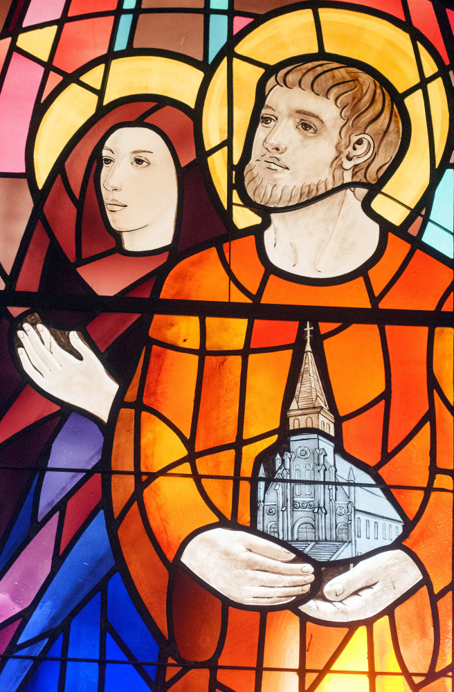 This image, showing part of a large stained glass window behind the choir loft, was taken on Friday at St. Augustine Church in Augusta. It shows Saints Monica, left, and Augustine, who is holding a model of the church building.