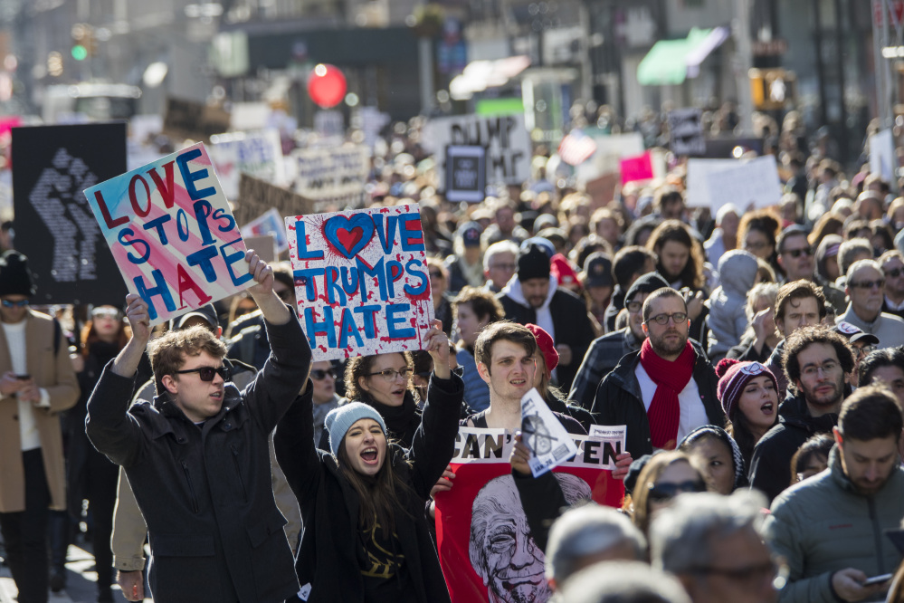 Demonstrators chant slogans as they march up 5th Avenue during a protest against the election of President-elect Donald Trump on Saturday in New York.