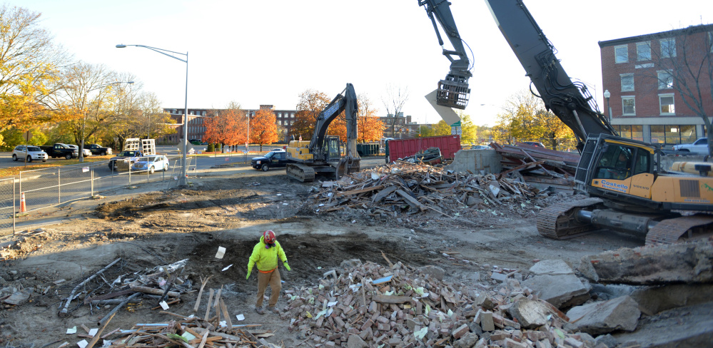 Crews from Costello Dismantling continue with the demolition of the former Levine's building in downtown Waterville on Nov. 1.