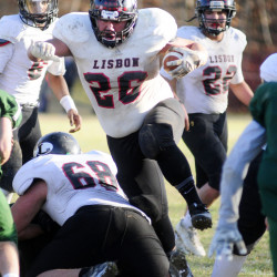 Lisbon running back Noah Francis hurdles one of his blockers during the Class D South championship game Saturday in Winthrop. Francis scored with 0.8 seconds left to give the Greyhounds a dramatic 20-17 victory over previously undefeated Winthrop/Monmouth.
