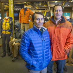 L.L. Bean service representative Will Moguel, left, wears this year's top-selling ultralight down jacket at the Freeport retailer, while A.J. Curran, the company's outerwear manager, dons the most popular seller from 10 years ago. The trend is toward lighter and more versatile winter wear.