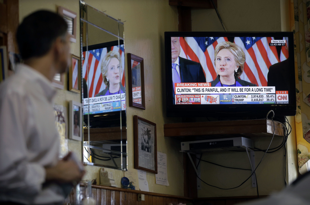 Nestor Papakonstantinou watches the televised concession speech by Democratic presidential candidate Hillary Clinton, Wednesday, Nov. 9, 2016, at the Maugus Restaurant  in Wellesley, Mass. (AP Photo/Steven Senne)