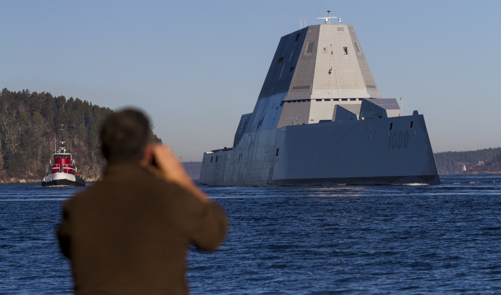 The Navy's newest destroyer, the Zumwalt, sails down the Kennebec River toward the Atlantic for a series of sea trials after leaving Bath Iron Works, where it was built.