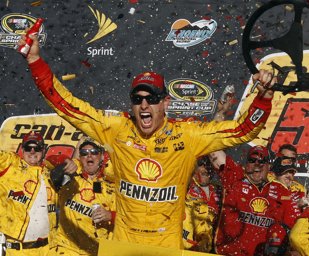 Joey Logano celebrates after he kept his Sprint Cup championship hopes alive with a victory Sunday at Phoenix International Raceway.