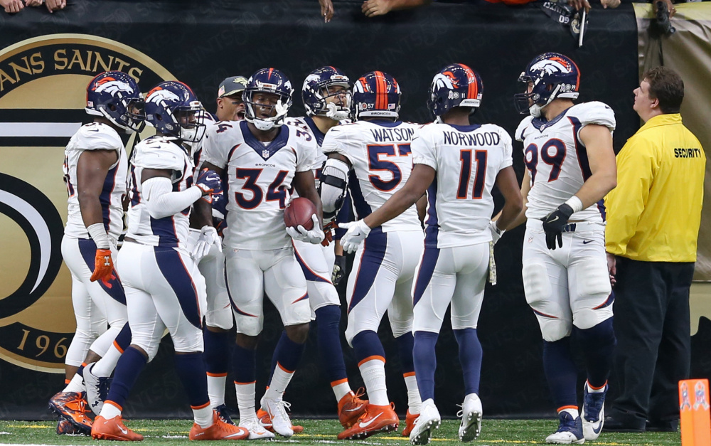 Denver Broncos defensive back Will Parks, 34, celebrates with teammates after scoring the first winning defensive 2-point conversion in NFL history on Sunday .