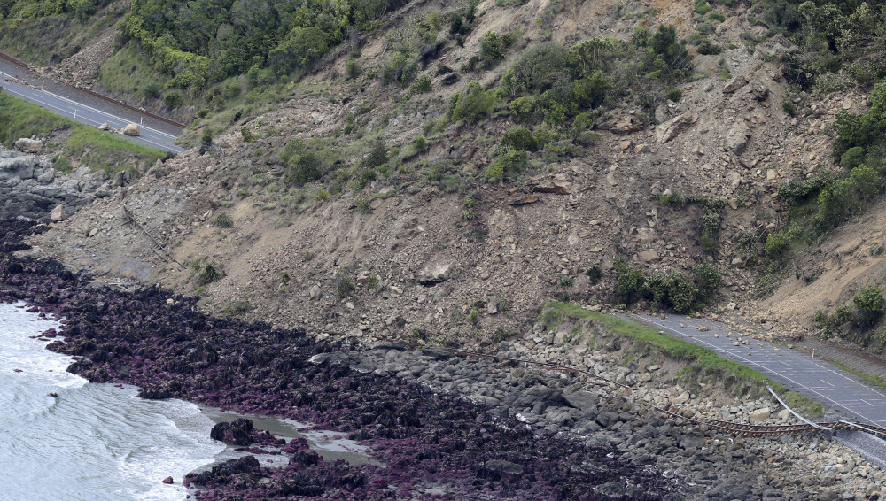 Railway tracks of the main trunk railway line are displaced by a massive landslide that also blocks State Highway One on the coastline north of Kaikoura, New Zealand, after a powerful earthquake Monday triggered landslides and a small tsunami.