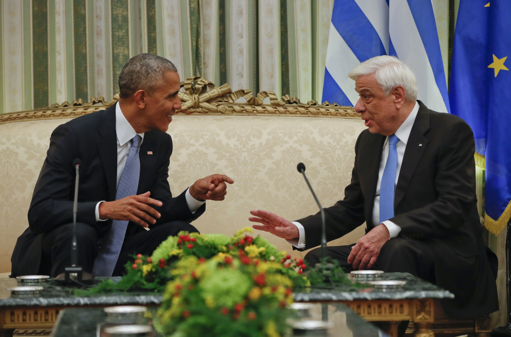 President Obama meets with his Greek counterpart Prokopis Pavlopoulos at the Presidential Mansion in Athens, Tuesday. Obama is scheduled to deliver a speech on Wednesday before heading to Berlin later the same day as part of his last major trip abroad.