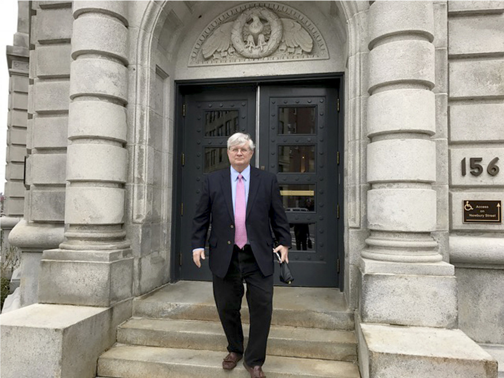 Dr. Joel Sabean leaves Portland's courthouse after closing arguments in his trial. He was found guilty of tax evasion and distributing controlled drugs.