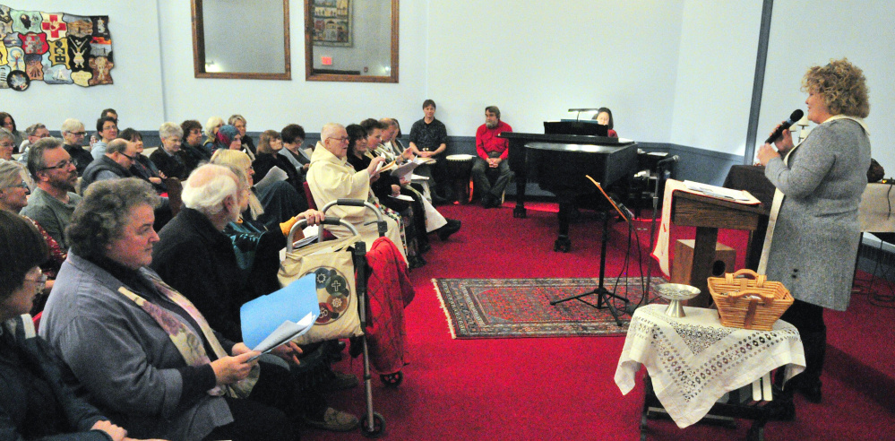 The Rev. Carie Johnsen, of the Unitarian Universalist Community Church, opens a multifaith service of healing, hope and unity Tuesday sponsored by Capital Area Multi-faith Association at Johnsen's church in Augusta.