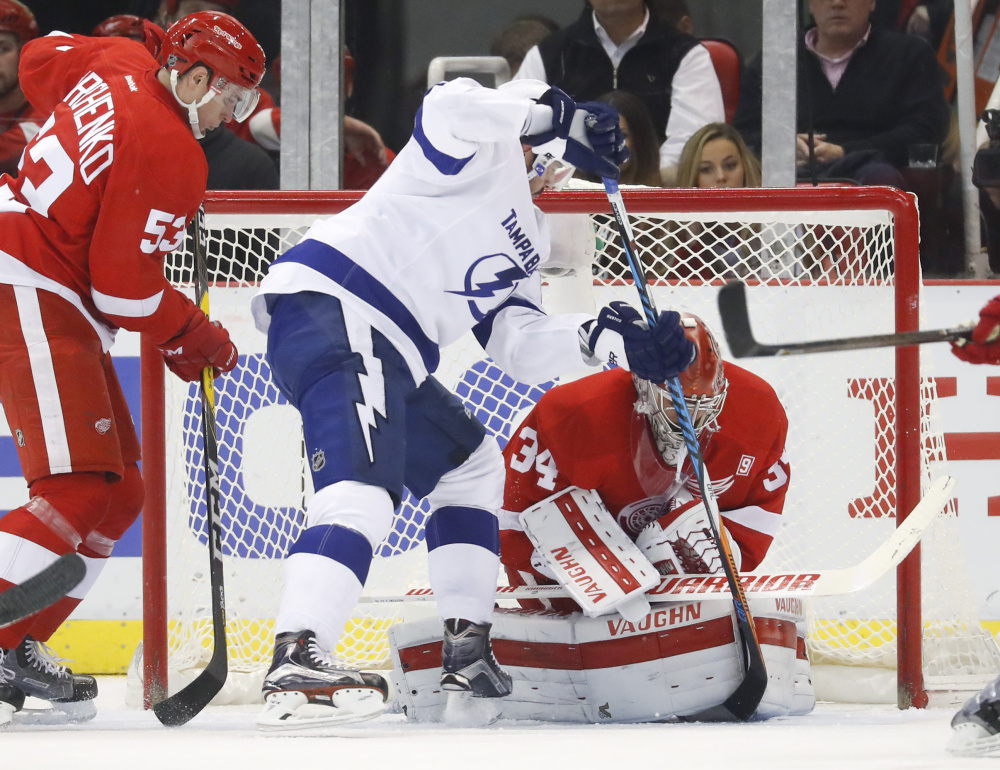 Red Wings goalie Petr Mrazek stops a shot by Tampa Bay's Alex Killorn in the second period Tuesday night in Detroit. The Lightning won, 4-3.