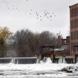 The eastern spillway, or dam, and the western spillway on the Presumpscot River in Westbrook could be removed as early as 2020 under an agreement that also calls for a fish passage and a reshaped river bottom to make it easier for fish to swim upstream.