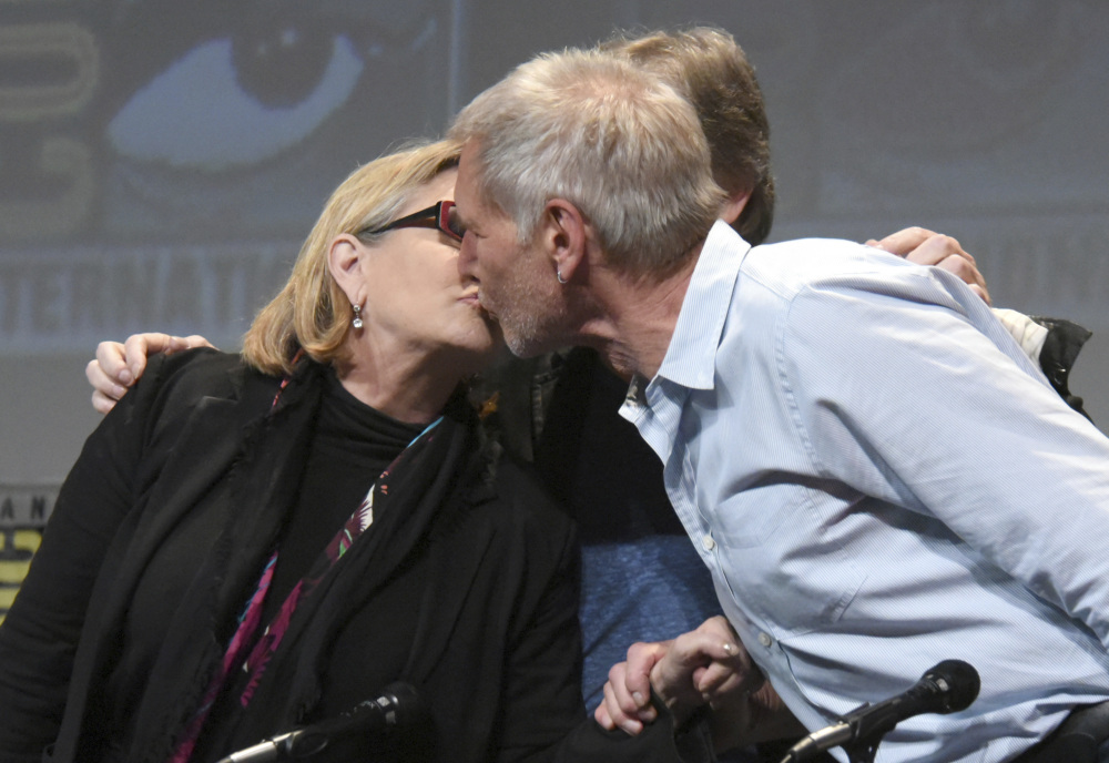Carrie Fisher and Harrison Ford kiss at Comic-Con in San Diego, Calif., in 2016.