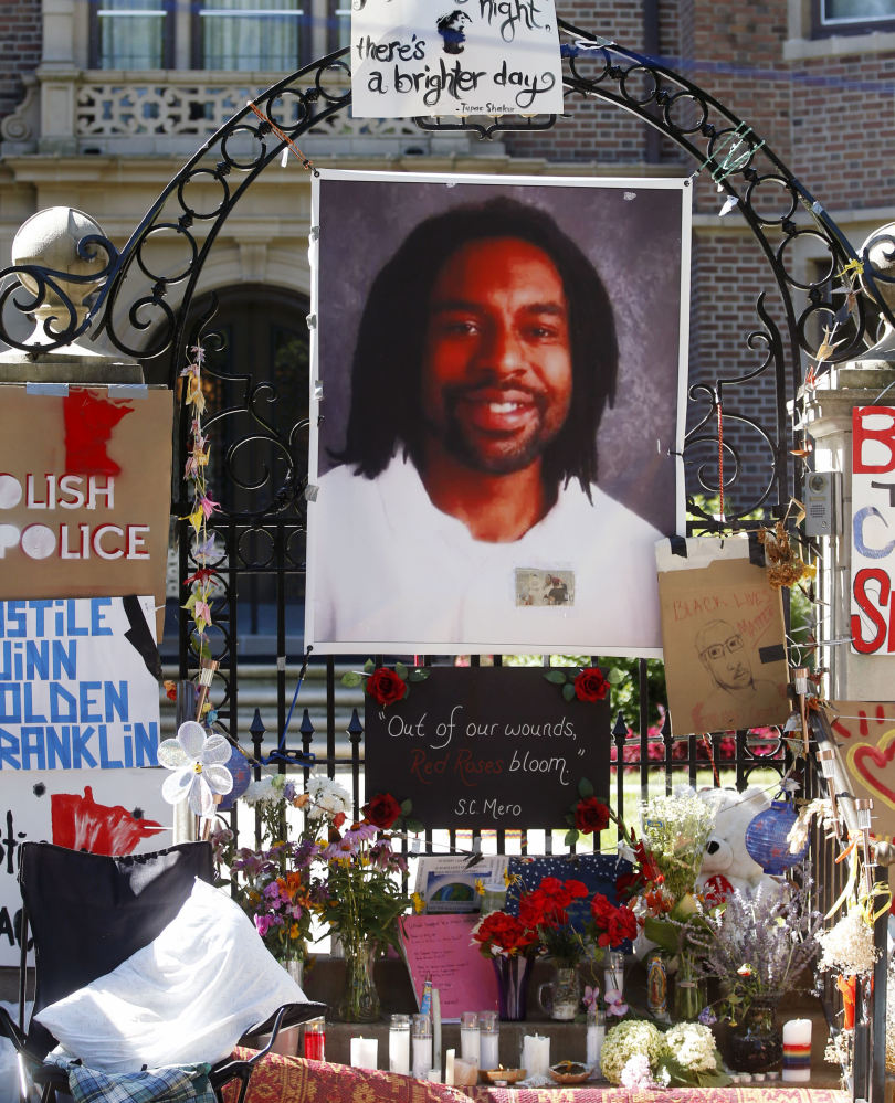A memorial including a photo of Philando Castile adorns the gate to the Minnesota governor's residence on July 25.