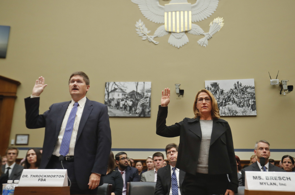 Mylan CEO Heather Bresch and Dr. Doug Throckmorton, deputy director, Center for Drug Evaluation and Research at the FDA, are sworn in on Capitol Hill before testifying before the House Oversight Committee.