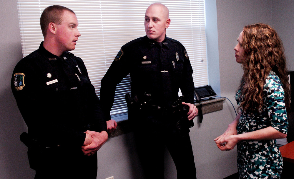 Waterville police officers Chase Fabian, left, and Ryan Dinsmore speak with Discovery House counselor Skyla Littlefield after an announcement of program Operation HOPE, or Heroin Opiate Prevention Effort, on Wednesday. The program combines enforcement, education and treatment for drug users.