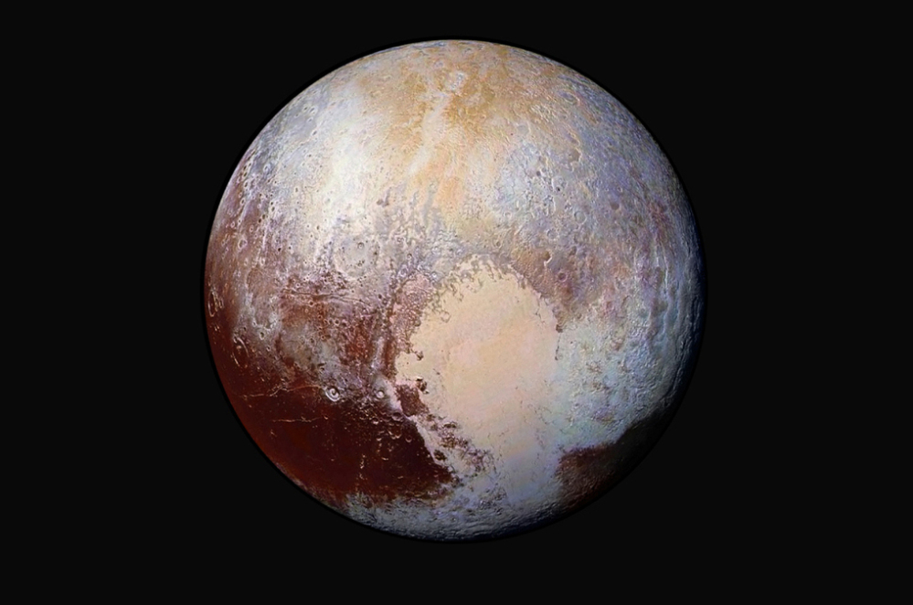 A July 24, 2015, combination of images of Pluto, captured by the New Horizons spacecraft. Wednesday scientists said an ice-filled impact basin may have acted as extra weight causing the planet to wobble away from its original axis spin.