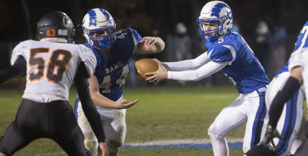 Tripp Bush of Kennebunk, right, learned about running an option offense with his dad, an assistant coach, at camps. Now he's the sophomore QB for a team seeking a state title.