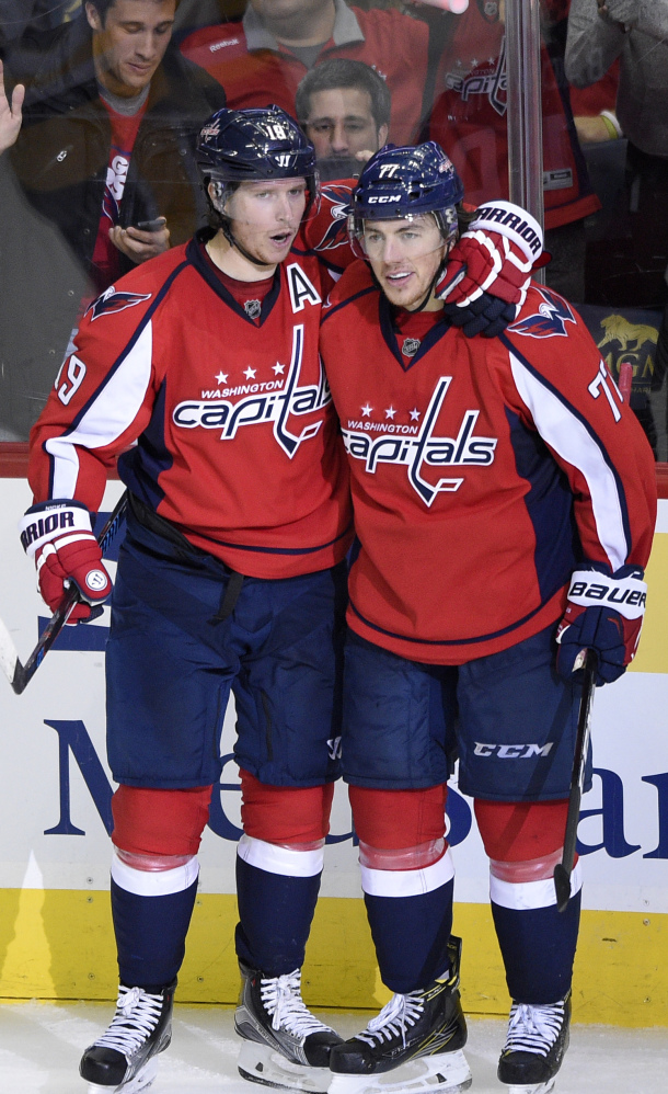 Nicklas Backstrom, left, and T.J. Oshie of the Capitals celebrate after Backstrom's second goal of the game in a 7-1 victory over Pittsburgh.