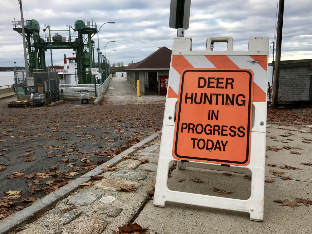 Signs placed near ferry landings alert islanders that Portland's annual deer hunt is underway. Hunters do not roam the islands; the deer are lured to designated bait sites.