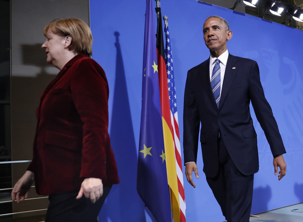 President Barack Obama and German Chancellor Angela Merkel leave after their joint news conference Thursday at the German Chancellery in Berlin.