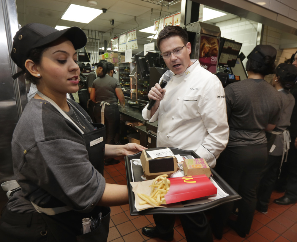 Table service is already available at McDonald's in some areas, including New York City, where company Executive Chef Dan Coudreaut checked an outgoing order Thursday. The restaurant chain plans to roll out the service nationwide.