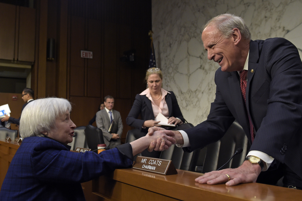 Federal Reserve Chair Janet Yellen, left, shakes hands with Joint Economic Committee Chairman Sen. Dan Coats, R-Ind. after she testified on Capitol Hill in Washington on Thursday.