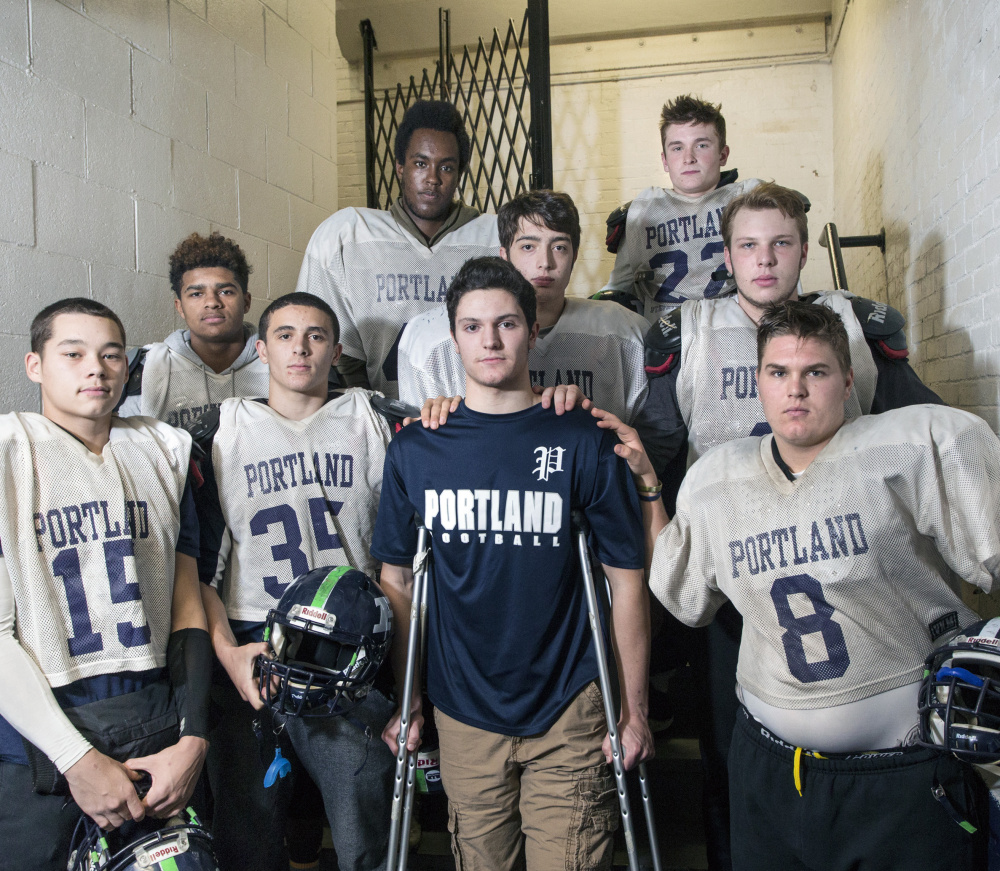 The Portland High seniors have rallied around Nick Archambault, who suffered a season-ending knee injury in the third game of the season. Archambault now helps break down film and counsels teammates during games.