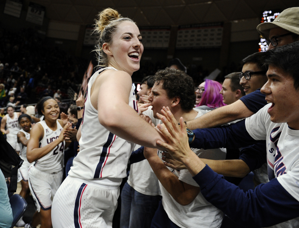 Connecticut's Katie Lou Samuelson and her teammates celebrate their 72-61 win over second-ranked Baylor on Thursday night with UConn students. The third-ranked Huskies have won 77 straight games.
