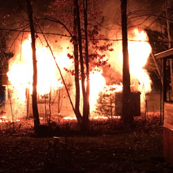The home at 10 Pettingill Road in Windham was engulfed in flames when firefighters arrived early Friday. Officials from the State Fire Marshal's Office said 60-year-old Marie McAllister died in the blaze.