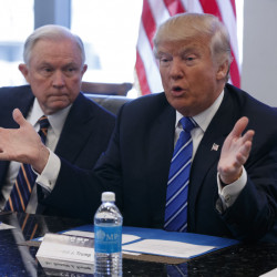 Sen. Jeff Sessions, R-Ala. listens at left as then-Republican presidential candidate Donald Trump speaks during an October national security meeting with advisers at Trump Tower in New York. Sessions is Trump's choice as attorney general.
