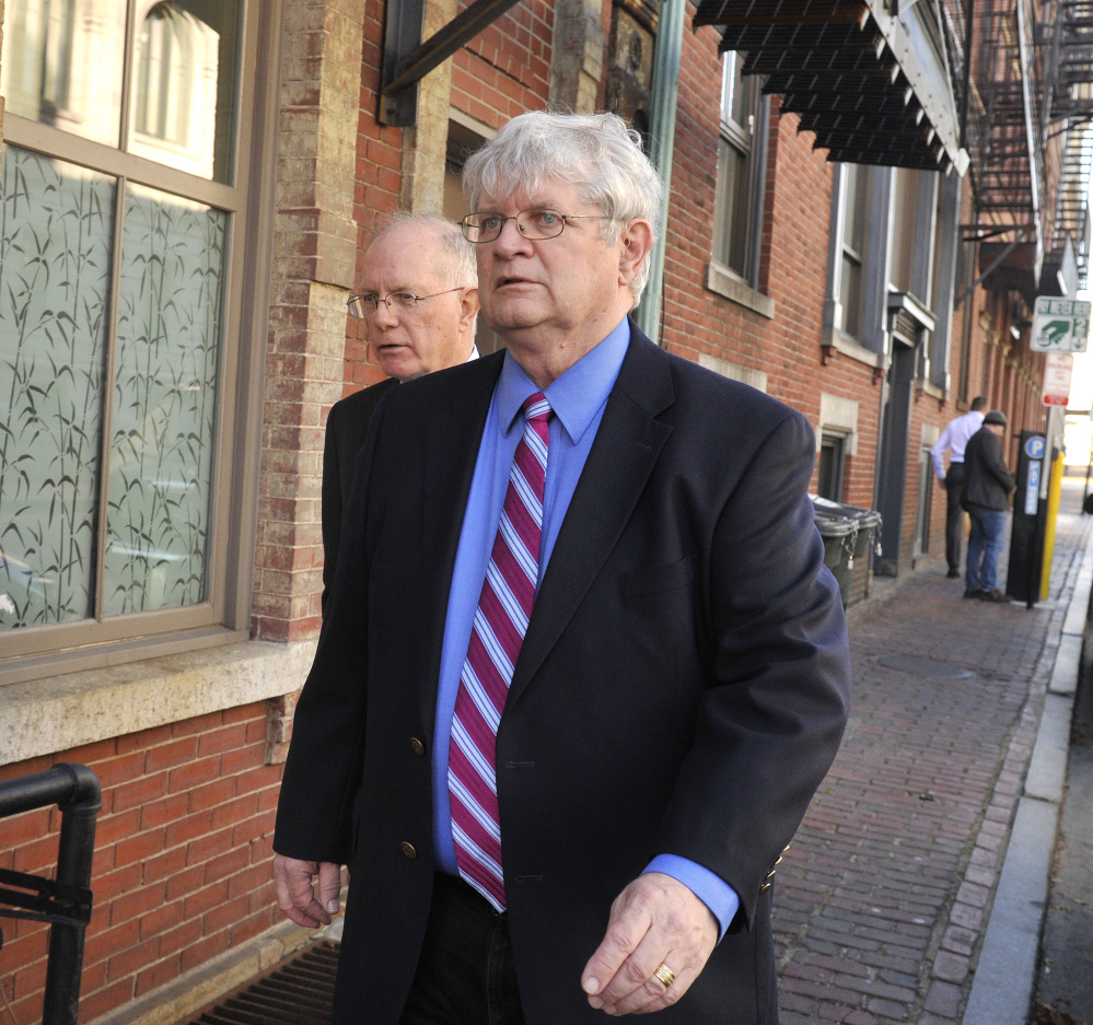 Dr. Joel Sabean, right, and attorney Jay McCloskey walk in the Old Port after his conviction in November.