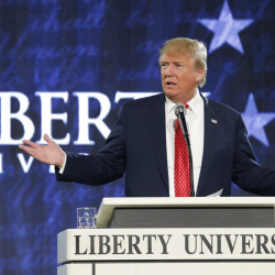 FILE - In this Jan. 18, 2016 file photo, Republican presidential candidate Donald Trump gestures during a speech at Liberty University in Lynchburg, Va. The list of prominent evangelicals denouncing Trump is growing, but is anyone in the flock listening?  The bloc of voters powering the real estate mogul through the Republican primaries is significantly weighted with white born-again Christians. As Trump's ascendancy forces the GOP establishment to confront how it lost touch with so many conservative voters, top evangelicals are facing their own dark night, wondering what has drawn so many Christians to a twice-divorced, profane casino magnate with a muddled record on abortion and gay marriage.  (AP Photo/Steve Helber, File)