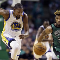 Golden State forward Kevin Durant and Boston guard Marcus Smart chase a loose ball in the third quarter of Friday night's rout by the Warriors in Boston.