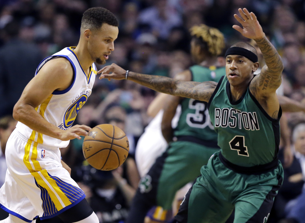 Stephen Curry drives against the Celtics' Isaiah Thomas in the first quarter of what turned out to be a one-sided game.